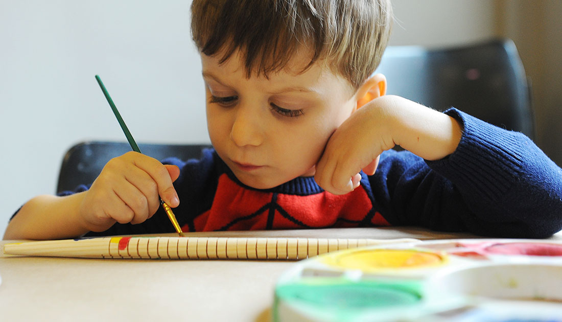 Preschooler paints