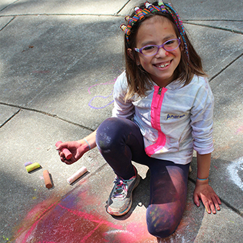 Camper draws with chalk