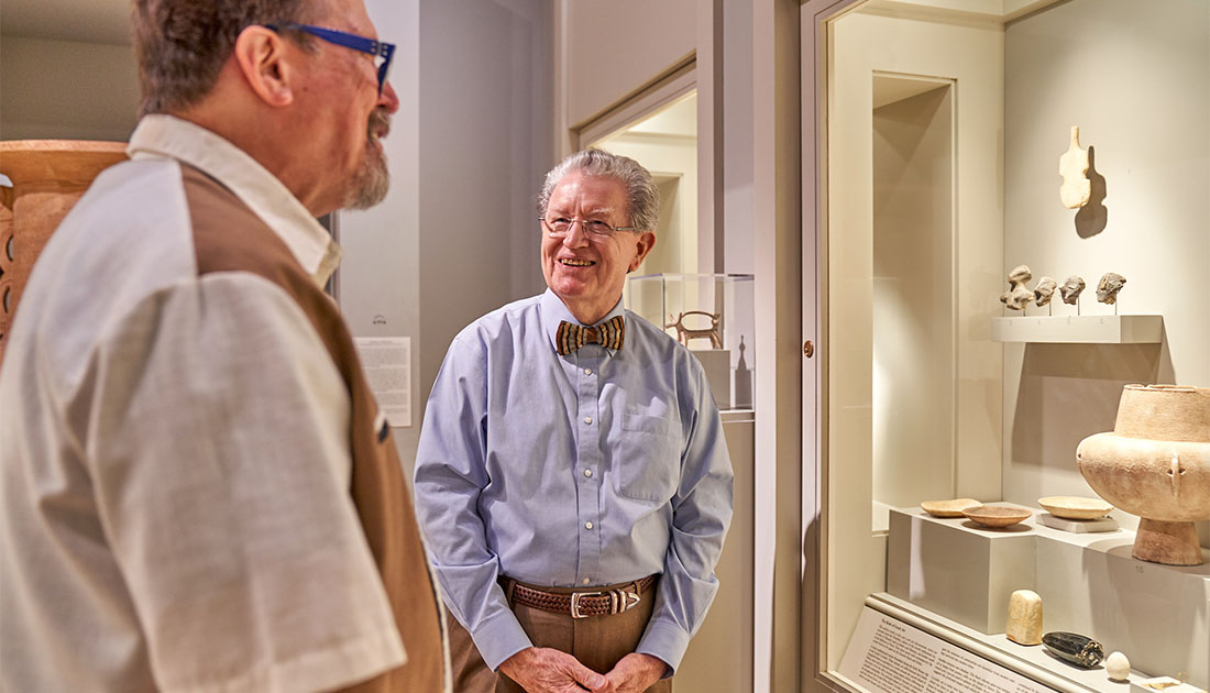 Visitor and docent in Greek and Roman gallery