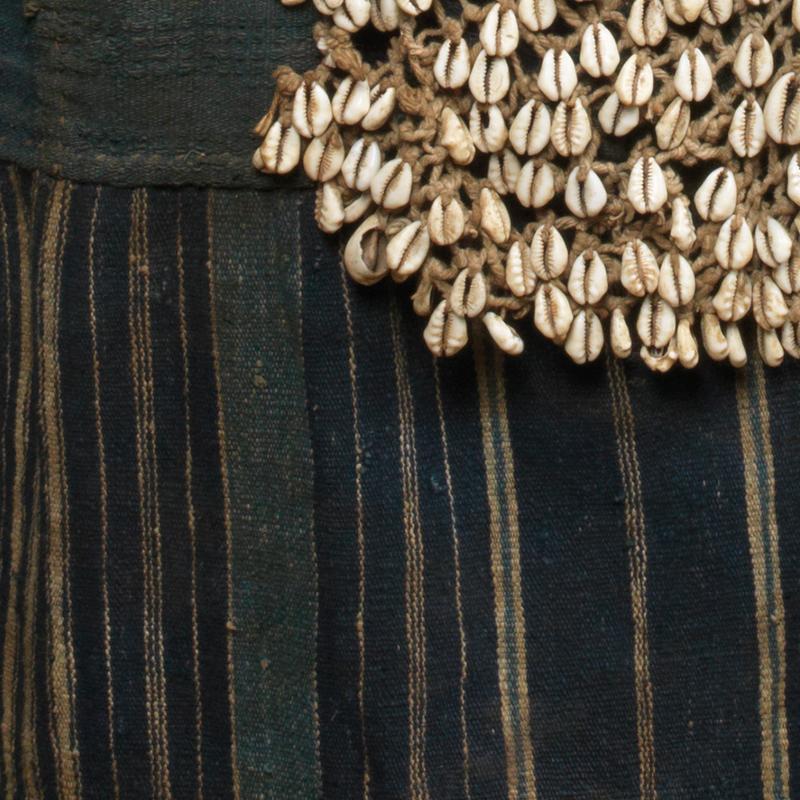 Egungun with cowrie shells
