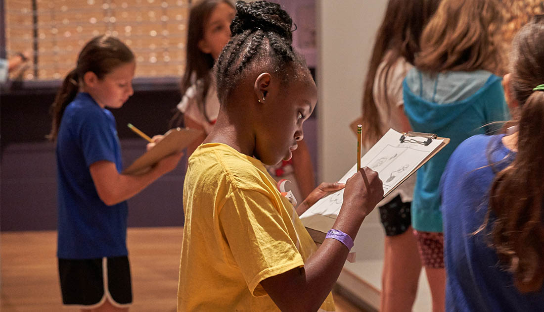 Students draw in the African gallery