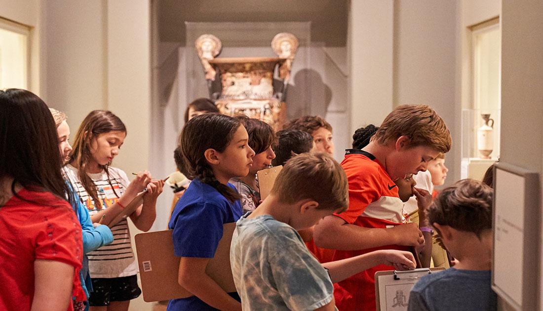 Students look at art