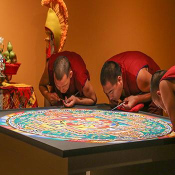 Monks create a sand mandala