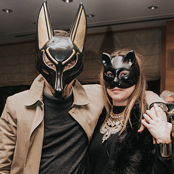 Party guests wearing masks