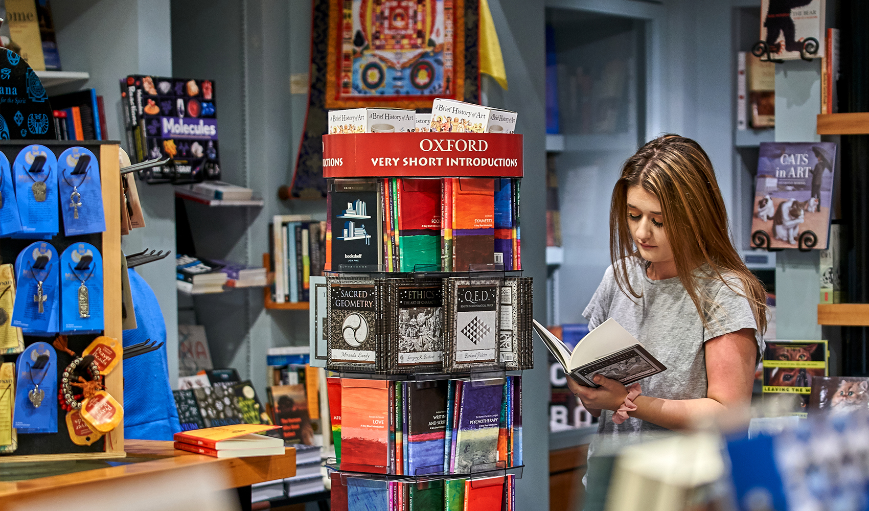 Shopper browses in the museum bookshop