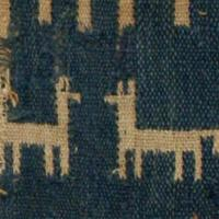 Fragment of fabric with llamas on it