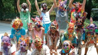 Campers wearing colorful masks
